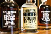 From left, Whitmeyer's Texas Single-Barrel Cask-Strength Straight Bourbon Whiskey ($70), Texas Moonshine Whiskey ($28) and Texas Peach-Flavoured Whiskey ($25)