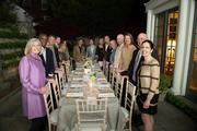 Smithsonian's Emily Willey, near left, and dinner guests on Law's terrace.