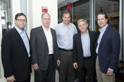 From left, Michael Cox, CEO of MCrowd Restaurant Group; Bob McNutt, Ray and Dick Washburne, owners of McCrowd Restaurant Group; and David Smith of Chevy Chase Land Co.