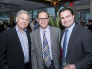 Mi Cocina held a party May 9 to celebrate its opening at The Collection in Chevy Chase. Attendees included, from left, David Smith of Chevy Chase Land Co., and Bill Miller and Alex Walker, both of Miller-Walker Real Estate.
