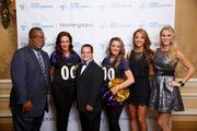 The Global Down Syndrome Foundation held its Be Beautiful Be Yourself Gala on May 8 at The Ritz-Carlton in D.C. The event helped raise awareness about the condition as well as highlight the abilities of people with Down syndrome. From left, Brownstein, Hyatt, Farber and Schreck's Marc Lampkin poses with two Baltimore Ravens cheerleaders, Global Down Syndrome Foundation model Alex Sessions (son of U.S. Rep. Pete Sessions, R-Texas) and two Washington Redskins cheerleaders.