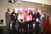 From left, Charles Debnam, Derrick Faison amd Stuart Berlow, all of the D.C. Cancer Consortium; Amari Pearson-Fields of the D.C. Department of Health; YaVonne Vaughan and Michele Coleman of the cancer consortium; D.C. Mayor Vincent Gray; and David Castañeda Díaz of the cancer consortium.