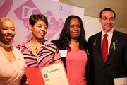 The D.C Cancer Consortium kicked off D.C. Goes Pink, an initiative in the Washington area to fight breast cancer, on May 9 at the Prince Hall Masonic Temple. D.C. Mayor Vincent Gray, at right, began the event by presenting the D.C. Cancer Consortium with a proclamation declaring May D.C. Goes Pink month. Shown with Gray are, from left, Amari Pearson-Fields, acting chief of the Bureau of Cancer and Chronic Disease and program manager of the Cancer Control and Screening Program; cancer consortium Executive Director YaVonne Vaughan; and Corporate Development and Strategic Partnerships Manager Michele Coleman.