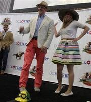 """The D.C. Lottery hosted a """"Day at the Derby"""" event May 15 at Union Station. Attendees included Gary Duke, chief brand strategist at MDB Communications, and Tara Chantal Silver, founder of SilverStrategy."""