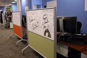 Employees express themselves on white boards at Walmart Labs.