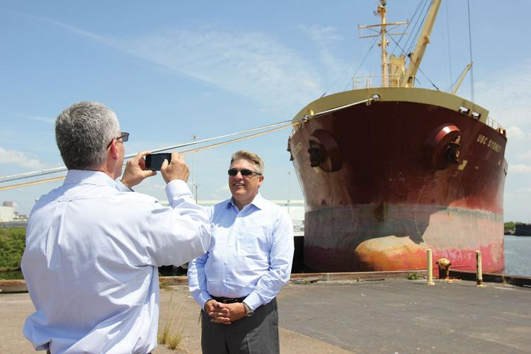 """Business Journal reporter Mark Holan records a """"One Question, One Minute"""" video with Port of Tampa CEO Paul Anderson during an interview."""