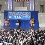 Michelle Obama travels to Baltimore to make final push for Brown