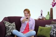 Katie Leclerc, a star in ABC Family's Switched at Birth, interacts with a Purple Communications device that allows people who use sign language to communicate with hearing people via video conference and a video interpreter.