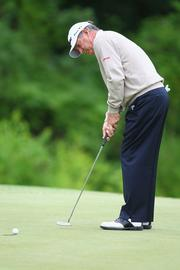Jay Haas sinks a putt on the 17th hole.