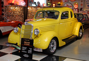 This 1935 Ford Deluxe Coupe, complete with a rumble seat, has a prime spot in George Passadore's showroom.