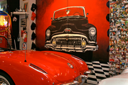 Whimsical wall art and photos of friends, family and events cover the walls of George Passadore's 4,000 square-foot collection space.