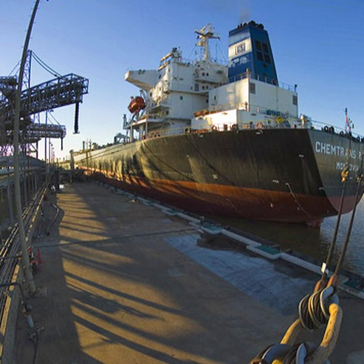 An oil tanker utilizes the dock of a Valero refinery in Port Arthur, Texas.