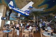 A Pan American Airways System plane hangs from the ceiling of the Margaritaville Restaurant at the Horseshoe Casino.