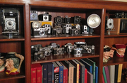Drew Klonsky showcases his Vintage camera collection at home in bookshelves around the house