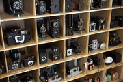 Drew Klonsky's estimates he has 200 to 300 vintage cameras and displays many in his office.