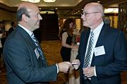 Peter Rockett of the Greater Boston Chamber of Commerce and Greg Pauplis of Wellesley Bank exchange business cards during the networking hour at the Boston Business Journal's Best in Boston Real Estate Awards luncheon held at the Sheraton Boston.