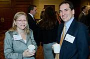 Barbara Goldman of KIPP Massachusetts and Larry Spang of Arrowstreet talk over coffee during the Boston Business Journal's Best in Boston Real Estate Awards luncheon.