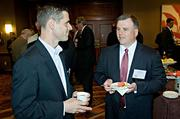 Chad Reilly of CBT Architects speaks with Ron Walker of CohnReznick a presenting partner of the Boston Business Journal's Best in Boston Real Estate Awards luncheon.