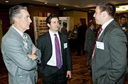 Tom Gall of ABM center speaks with Integrated Builders Bill Mack left and Sean Burgess  during the networking hour at the Boston Business Journal's Best in Boston Real Estate Awards luncheon held at the Sheraton Boston.