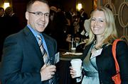 Mark Shapiro of Calare Properties and Corinne Maleski of ahp Architects socialize during the networking hour at the Boston Business Journal's Best in Boston Real Estate Awards luncheon held at the Sheraton Boston.