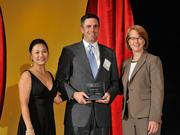 Jason Mahoney accepts the 2013 Forty Under 40 award alongside Dean Joanne LI of Wright State University, the title sponsor, and DBJ Publisher Carol Clark.