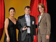 Aaron Miller accepts the 2013 Forty Under 40 award alongside Dean Joanne LI of Wright State University, the title sponsor, and DBJ Publisher Carol Clark.