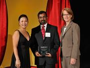 Anandapadmanaban Perumalchettiar accepts the 2013 Forty Under 40 award alongside Dean Joanne LI of Wright State University, the title sponsor, and DBJ Publisher Carol Clark.