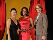 Shanda McKinney accepts the 2013 Forty Under 40 award alongside Dean Joanne LI of Wright State University, the title sponsor, and DBJ Publisher Carol Clark.