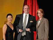 Terry W. Posey Jr. accepts the 2013 Forty Under 40 award alongside Dean Joanne LI of Wright State University, the title sponsor, and DBJ Publisher Carol Clark.