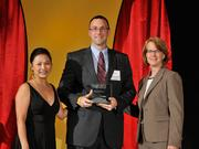 Thomas Petrovic accepts the 2013 Forty Under 40 award alongside Dean Joanne LI of Wright State University, the title sponsor, and DBJ Publisher Carol Clark.