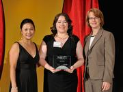 Erica Shafer accepts the 2013 Forty Under 40 award alongside Dean Joanne LI of Wright State University, the title sponsor, and DBJ Publisher Carol Clark.