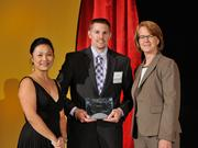 Jeff Stone accepts the 2013 Forty Under 40 award alongside Dean Joanne LI of Wright State University, the title sponsor, and DBJ Publisher Carol Clark.