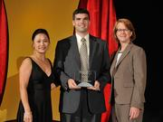 Joshua Styrcula accepts the 2013 Forty Under 40 award alongside Dean Joanne LI of Wright State University, the title sponsor, and DBJ Publisher Carol Clark.