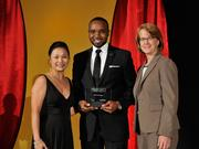 Charles Warnsley II accepts the 2013 Forty Under 40 award alongside Dean Joanne LI of Wright State University, the title sponsor, and DBJ Publisher Carol Clark.