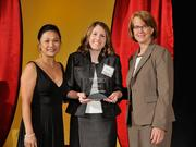 Sarah Worley accepts the 2013 Forty Under 40 award alongside Dean Joanne LI of Wright State University, the title sponsor, and DBJ Publisher Carol Clark.