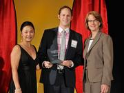 Casey Weinstein accepts the 2013 Forty Under 40 award alongside Dean Joanne LI of Wright State University, the title sponsor, and DBJ Publisher Carol Clark.