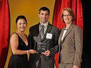 Dr. Mark Zunkiewicz accepts the 2013 Forty Under 40 award alongside Dean Joanne LI of Wright State University, the title sponsor, and DBJ Publisher Carol Clark.