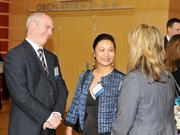 Dr. Joanne Li (center) speaks with other guests at the event.