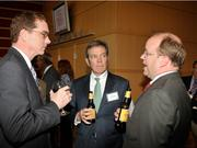 Chris Carrigg of Freund, Freeze & Arnold speaks with other guests.