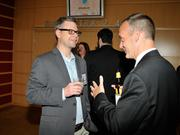 Chris Wire (left) and Jeff Hoagland talk during the cocktail reception.