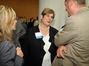 Becky Cole of Wright State University talks with guests.