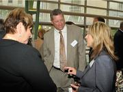 Dough Fecher, CEO of Wright-Patt Credit Union, talks with guests at the event.