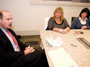 Attorney Hugh Russ III meets with Flight 3407 widows Jennifer West, center and Robin Tolsma a year after the crash.
