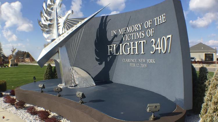 Flight 3407 memorials are located on Transit Road, above, and at the crash site in on Long Street in Clarence.