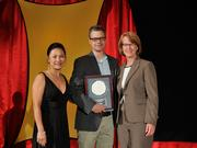 Chris Wire accepts the 2013 Forty Under 40 Hall of Fame induction honor alongside Dean Joanne LI of Wright State University, the title sponsor, and DBJ Publisher Carol Clark.