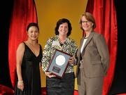 Judge Mary Wiseman accepts the 2013 Forty Under 40 Hall of Fame induction honor alongside Dean Joanne LI of Wright State University, the title sponsor, and DBJ Publisher Carol Clark.