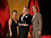Val Beerbower accepts the 2013 Forty Under 40 award alongside Dean Joanne LI of Wright State University, the title sponsor, and DBJ Publisher Carol Clark.