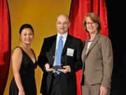 Scot Clyne accepts the 2013 Forty Under 40 award alongside Dean Joanne LI of Wright State University, the title sponsor, and DBJ Publisher Carol Clark.
