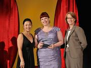 Heather Boehmer accepts the 2013 Forty Under 40 award alongside Dean Joanne LI of Wright State University, the title sponsor, and DBJ Publisher Carol Clark.