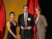 Mark Engling accepts the 2013 Forty Under 40 award alongside Dean Joanne LI of Wright State University, the title sponsor, and DBJ Publisher Carol Clark.